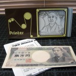 SOLD T-109 MIDAS MACHINE —  Rarer Brown Case with Mechanics to Perform Trick with 10,000 Yen Bank Note. One-Sided Repro of Required Bank Note and Repro English Instructions Included. $75 SOLD