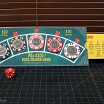 My own version of Four Chance that I made with genuine metal core poker chips held in place w. magnets. The instructions sheet sides out from the side of the game board.