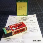 The Tenyo Stylized Kanji Logo on the Back of the Small Box and the Instructions for the Japanese Packaged Astro Coin