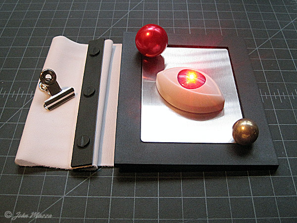 The Great Escape can be used with other small dimensional objects. Also, small dimensional items from exisitng Tenyo Magic Tricks can be used to make combination presentations. T-163 Burglar Ball, T-250 The Third Eye (melts while flashing) , T-261 The Alchemist would be good candidates to combine with The Great Escape.