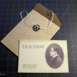 The secret message that Harry Houdini arranged with his wife Bess is written on the reverse side of Houdini's business card
